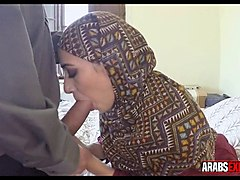 clothed arab woman gets on her knees for american cock