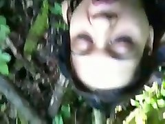 attractive girl takes big dick in her mouth giving head in a forest