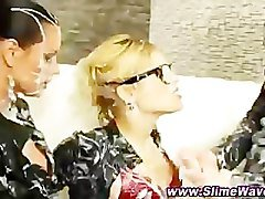 Classy clothed lesbo sluts gets covered in cum from plastic cocks