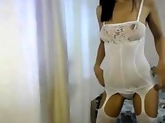 cute petite babe in white lingerie teasing