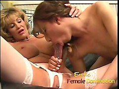 mature blonde dominating a sexy shemale with a big strap-on