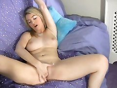 Alluring Blonde Teen Fingers And Toys Her Pussy