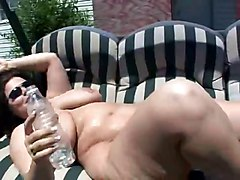 Mom With Big Tits Sunbathing Outdoors