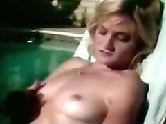 two blonde babes greedily sucking one dick by the pool