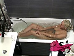 blonde sweetheart plays with pussy in the bathtub
