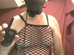mature woman in facial mask and fishnet top webcamming with me
